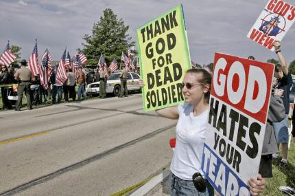 Megan Phelps picketing the funeral of a dead soldier in 2010 (Photo Pickling In His Presence)